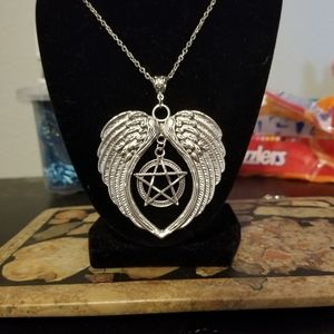 Oversized Wiccan winged pendant